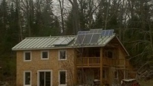 This customer's Sundog Solar off-grid electric system is comprised of PV panels, inverter, charge controller and six Rolls Surette batteries and solar hot water system, backed up by a wood stove. Our customer milled the wood for his home, which also utilizes geothermal principles.